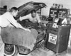 Drakes Standard Oil Service Station. Theron Sutton, left, and Bob Drake checking out a new tuneup machine.