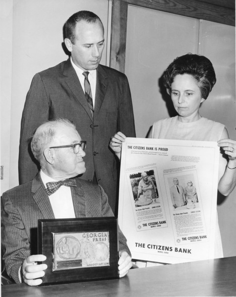 Citizens Bank of Nashville. M.E. Perry, seated, Guy Tittle and Sue Powell
