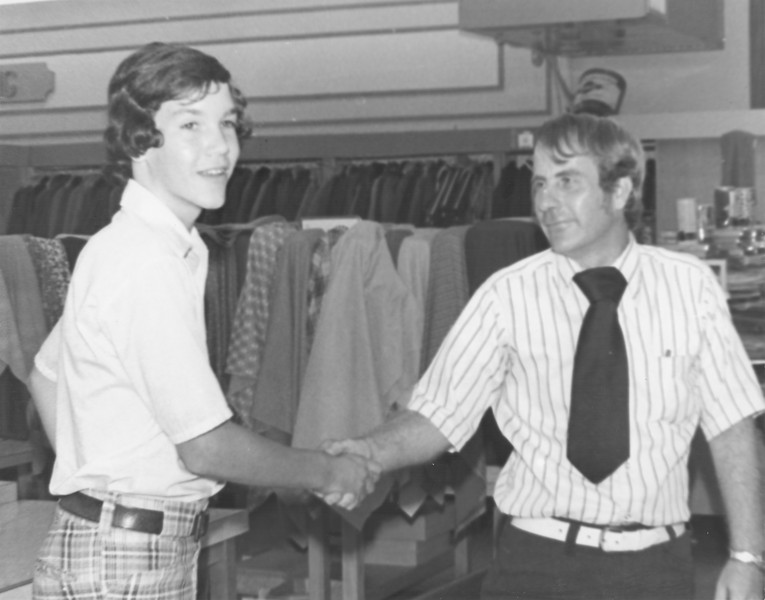 B.C. Moore's Department Store, Jeff Busbee (left), campaigning for his father George, (right) J.W. Pitts, store manager, August 1974