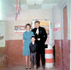 Evelyn, Jack and Ricky Kent, inside lobby of Majestic Theatre, circa 1960s.