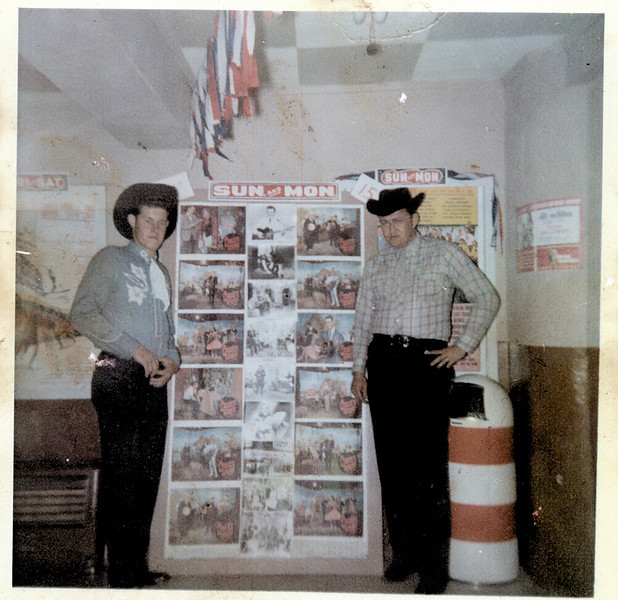 Unknown male and Jack Kent inside lobby of Majestic Theatre, circa 1960s.