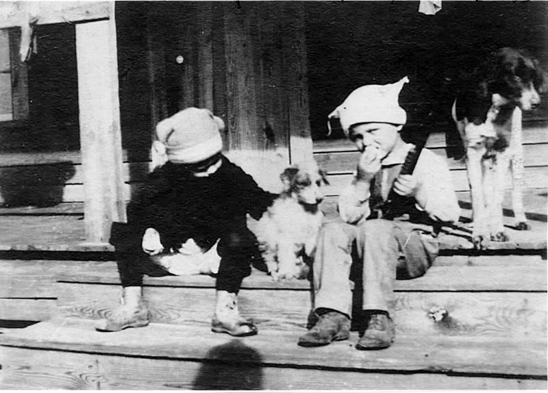 Berrien Lumber Company, also known as Ruby Sawmill, operated by Drew Fuller from about 1918 to 1925. It was located in the community of Ruby three miles west of Nashville off of the Adel Highway. Kyle Fuller and a friend on porch at the home in Ruby. Jack the dog.