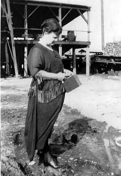Berrien Lumber Company. Building where timber was debarked and cut is shown.  Mrs D. C.'Lula' Fuller holding box camera.