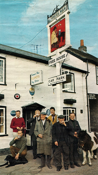 "<center><font size=3><u> - Old Farmer's Man - Early 70s - </u></font> (BS0998) </center>  Group of the ""regulars"" outside the old Farmers Man in the early 1970s.    Known personalities appear to be:  - Kneeling with dog, Tim Lamb, ex RAF licensee of the pub - Above, with red pullover, unknown.  May be Tim Lamb's successor or sweet shop owner following Eva Saw? - Background, drinking pint, Alec Vaughan. - George Dixon in flat hat. - Yellow waist coat unknown.  - ""Ken"" (Kenneth Rolland) Passey  - ""Joey"" the Shetland pony"
