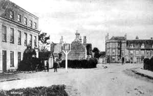 "<font size=3><u> - White Hart - </u></font> (BS0044)  To the left of the inn sign is the small building which garaged the Benson Fire Engine, and doubled as the village mortuary when necessary.    For more detail, see page 190 of ""Benson, A Century of Change""."