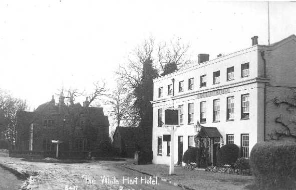 <center><font size=3><u> - White Hart - </u></font> (BS0057) </center>  White Hart pre 1920 (no War Memorial).  Note roads not macadamised