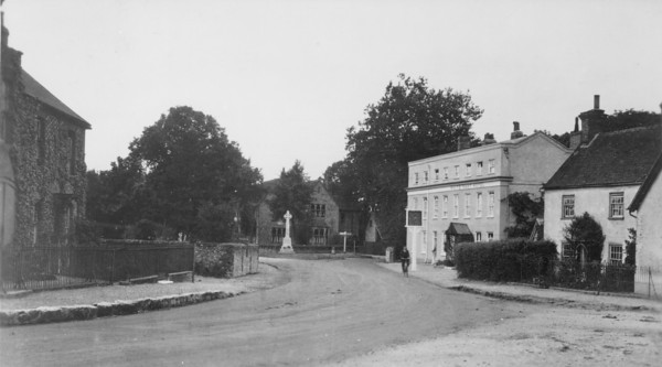 <font size=3><u> - White Hart - </u></font> (BS0059)  White Hart post 1920, but probably late 20s.  Note existence of War Memorial, but roads still not made up.  Compare with BS0057.  Note also the small building to the right of the hotel, which housed the fire engine (seeBS0052) and sometimes village mortuary.