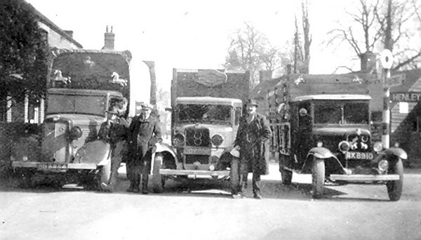 <center><font size=3><u> - Bert Passey (centre) with his scrapyard vehicles -  </u></font> (BS0525) c.1950 across Brook Street by Wisteria Cottage. Who are the other two family members?<center>