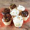 Homemade white and chocolate cupcakes.