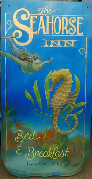 'seahorse inn' wooden sign with mermaid