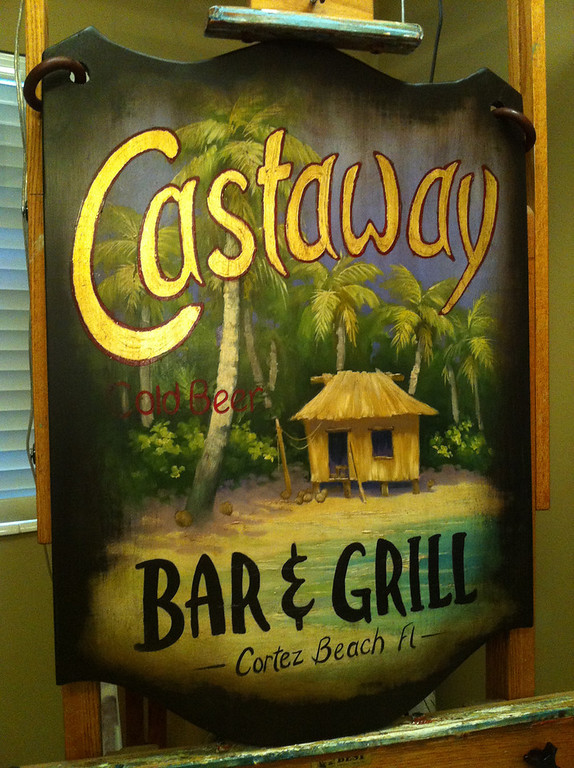 'castaway' bar and grill wooden sign
