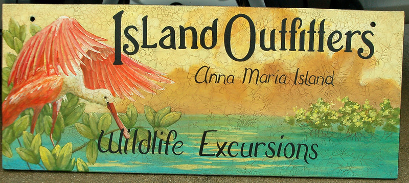 'Island Outfitters' outdoor sign with rosetta spoonbill
