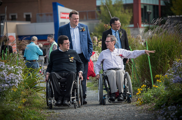 Sept. 22nd. 2017 - Rick Hansen Healing Garden - Halifax Mayor Mike Savage, left rear, Speaker of the House, Kevin Murphy, front left,  Gerry Post Executive Director for Accessibility for Nova Scotia, centre front right, and , and Senator Dan Christmas, right rear, walk through Common Roots Urban Farm in Halifax during an event celebrating the Rick Hansen Healing Garden.  Thanks to infrastructure improvements funded by the Rick Hansen Foundation Access4All Barrier Buster program,  the farm now has wheelchair-accessible raised garden beds,  garden plots for the blind, and accessible pathways through the farm.  (Photo by Sándor Fizli/Common Roots Urban Farm)