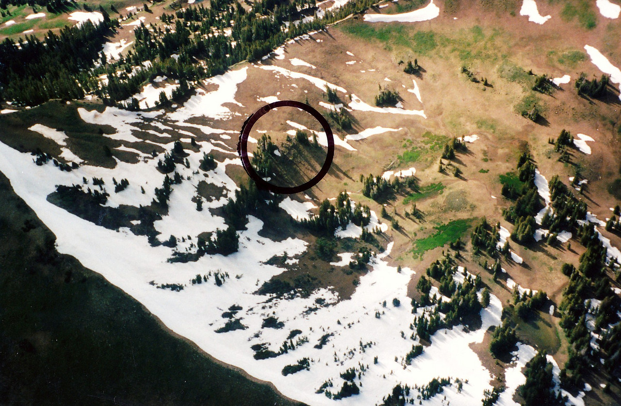 This aerial photo taken in late June illustrates the amount of snow that remains on 10,000 foot Humpy Ridge. At these upper elevations, there is a small window of opportunity for a hike in.