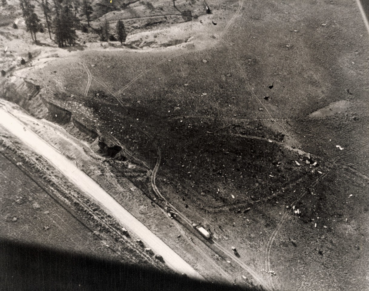 THE ACCIDENT SITE - 1947<br /> <br /> The crash site as seen from the Cessna shows the utter devastation created by the DC-6 as it slammed into the top of the plateau.