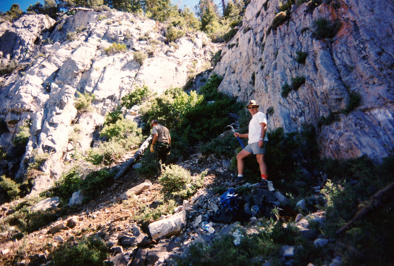 At the main impact site during a 1995 visit. The aircraft struck the cliff face behind me. (Lostflights Photo)