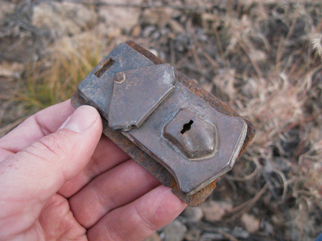 OTHER ARTIFACTS OF TWA FLIGHT 3:<br /> <br /> A locking luggage latch from a passenger or flightcrew member's suitcase. (Lostflights Photo)