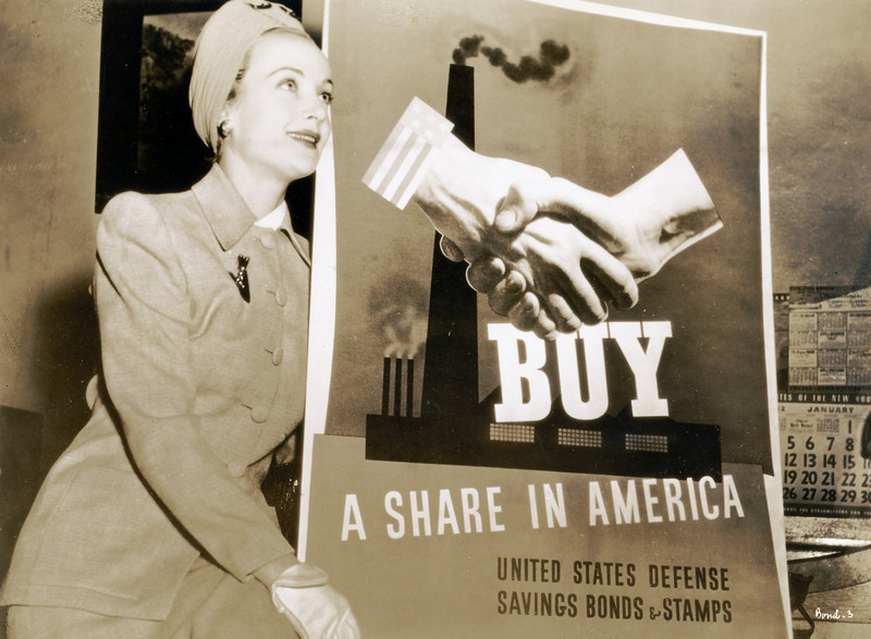 Within a month after the December 7, 1941 attack of Pearl Harbor by Japan, Carole Lombard began a ten day war bond tour on behalf of the Hollywood Victory Committee. Initially, Clark Gable was to accompany her, but prior film engagements prevented that from happening. <br /> <br /> Carole's trip began by train from Los Angeles to Chicago via Salt Lake City and small stops along the way. Traveling with Carole was her mother Elizabeth Peters with close family friend and MGM Studio Publicist, Otto Winkler.<br /> <br /> The return home was to have also been made by train, but Carole wanted to get home as soon as possible. Otto Winkler found a TWA flight leaving in the early morning hours. <br /> <br /> It was decided that they would fly home but when Carole's mother, a numerologist heard that it was TWA Flight 3 she got a bad feeling that the number three was unlucky (TWA Flight THREE, THREE people in their party, and the plane would be a DC-THREE). As legend has it, a simple coin toss suggested by Carole finalized the decision to fly.<br /> <br /> Here we see Carole during her stop in Chicago on January 14, 1942. (LostFlights Photo)