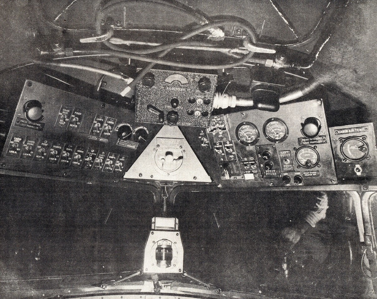 The overhead panel contained the magnetic compass, light switches, and other gauges and switches (TWA Photo).