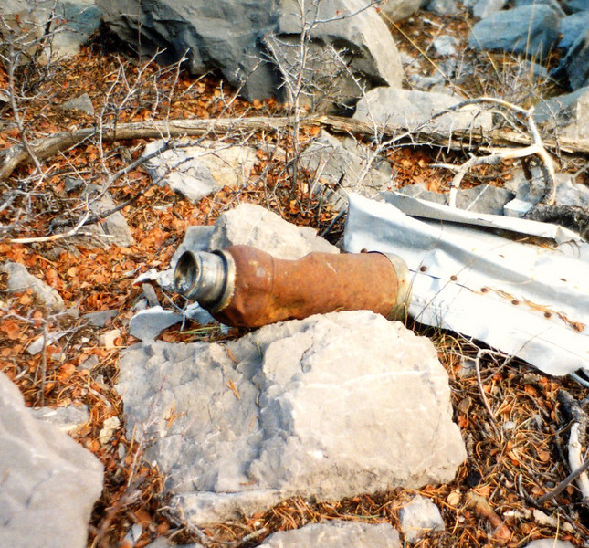 A mangled Thermos beverage container. These beverage containers were used by the airline to keep coffee hot on cold flights. (LostFlights Photo)