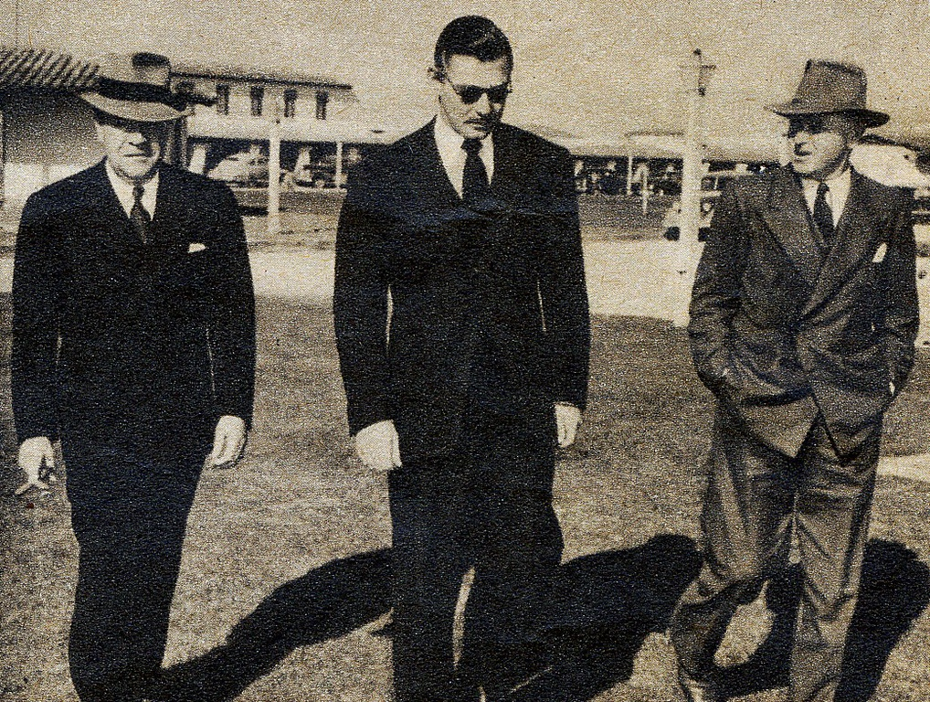 AFTERMATH OF TWA FLIGHT 3:<br /> <br /> Clark Gable flanked by MGM Studio chief Eddie Mannix (left) and close friend Howard Strickland (right) leaving the El Rancho Hotel in Las Vegas after receiving word of no survivors.