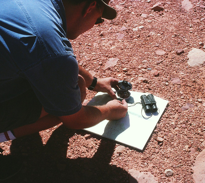 In the early to mid 1980's, all my crash site searches were conducted with topographic maps, magnetic compass, and not-to-mention a lot of luck. Here I am plotting my location in relation to Potosi Mountain. (Lostflights Photo)