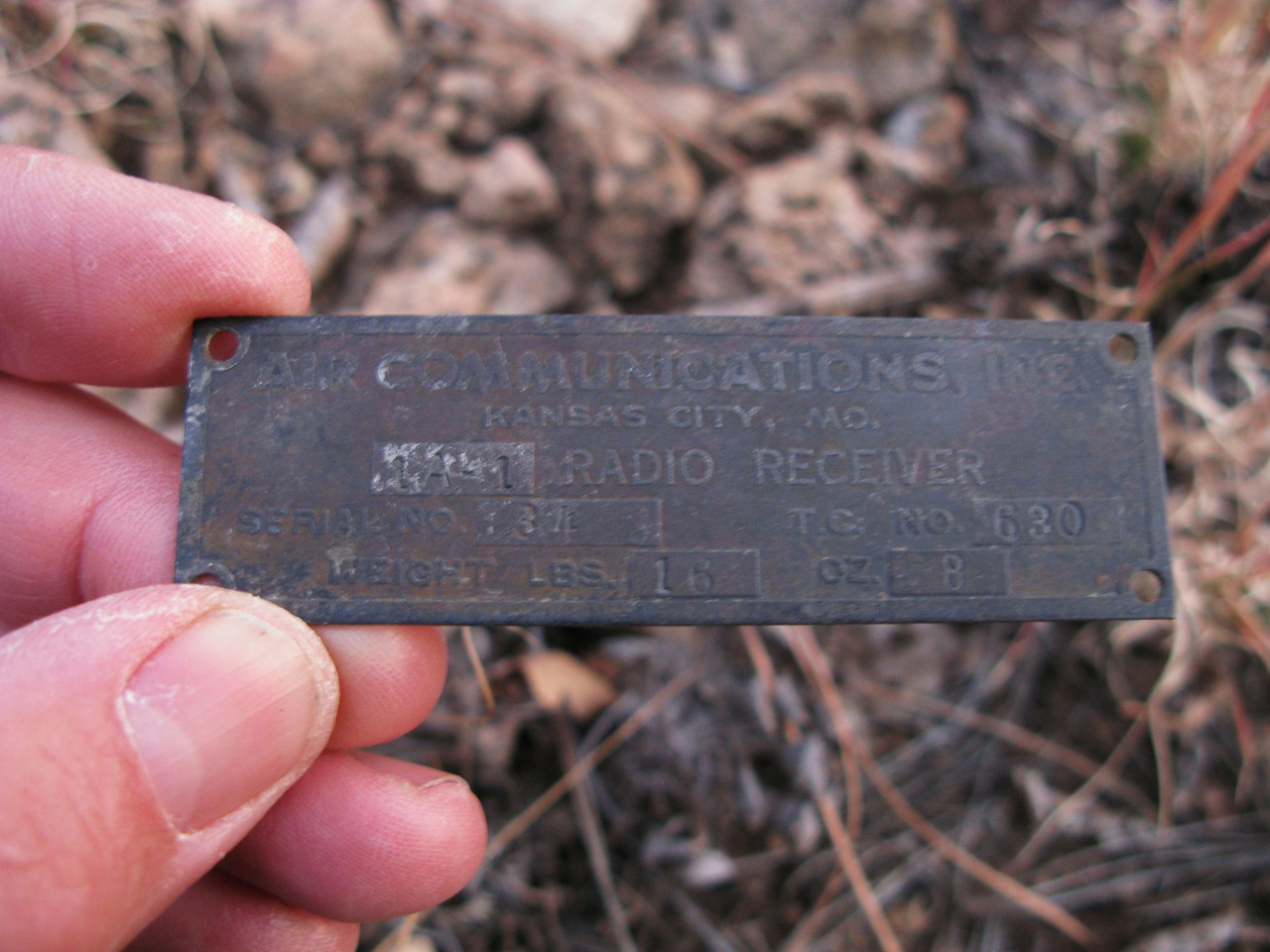 This equipment placard was from the aircraft's radio receiver. (Lostflights Photo)