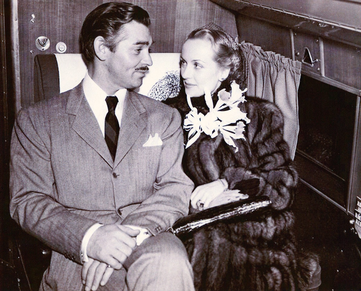 "The Gables, just like many other celebrities of the time utilized the airlines to travel to special events and engagements. <br /> <br /> In this photo, we see Clark and Carole Lombard Gable traveling on an American Airlines Douglas DC-3 for the December 15, 1939 premier of the film ""Gone With The Wind"" in Atlanta."