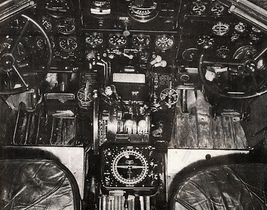 The flight compartment on an early 1940's era TWA Douglas DC-3. Center pedestal with throttle, propeller and fuel mixture levers.   Between the two pilot's seats is the Sperry Automatic Direction Finder which played a significant roll into the disaster and will be discussed later. (TWA Photo)