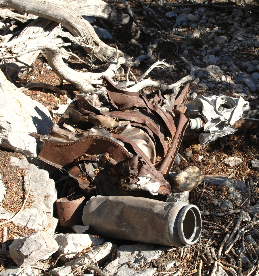 Wreckage fragments with a portable aircraft fire extinguisher canister in the foreground. (Lostflights Photo)