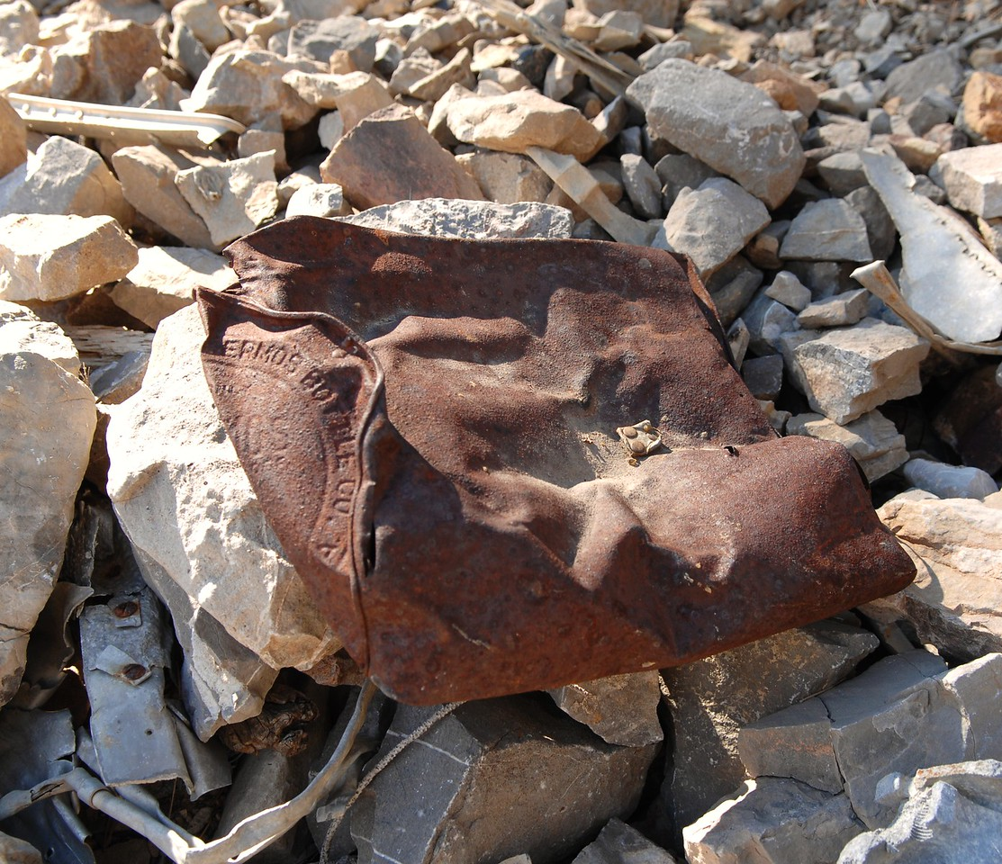 An ice bucket manufactured by the Thermos Bottle Co. sits amid the boulder/rock covered wreckage. (Lostflights Photo)