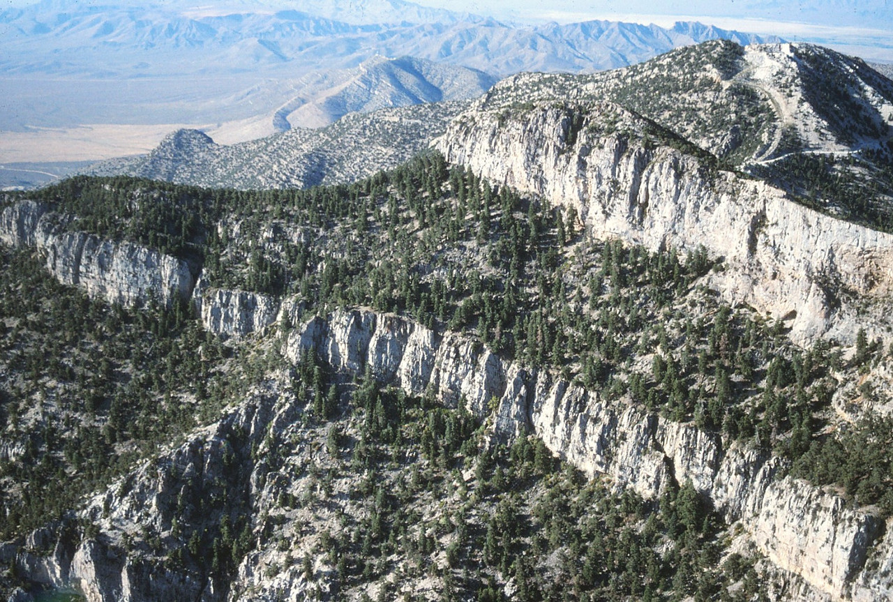 Potosi Mountain is very difficult to fly over since the northeast face curves right to form an east face. This required me to fly low toward the mountain, but to keep turning right. Trying to do this and photograph while not hitting the side of the mountain was difficult. (Lostflights Photo)