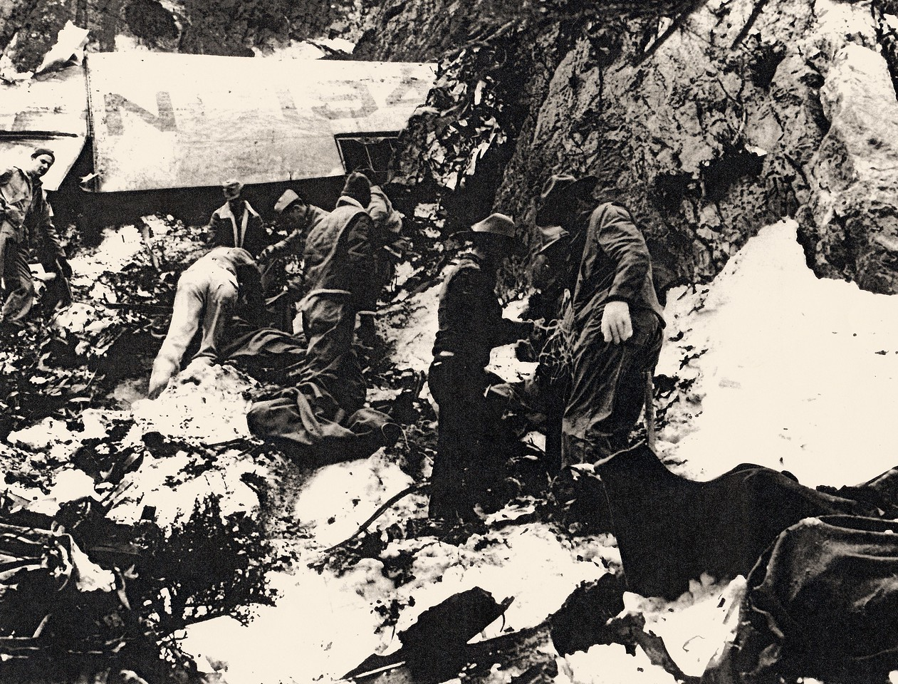 THE RECOVERY OPERATION - 1942<br /> <br /> Recovery team members sifting through the wreckage. (Bettman Archives)