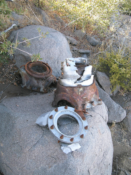 We located one of the propeller dome assemblies, but someone, possibly CAB accident investigators disassembled the hub during the on-site investigation. The only propeller blades located at the site were small fragments.