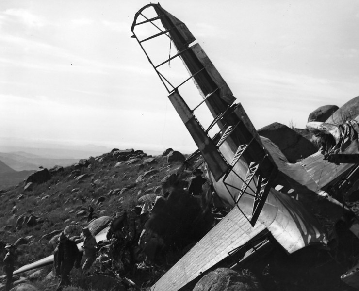 1946 - The DC-3's tail section lies amid the boulders of Cuyapaipe Mountain. (Courtesy of Craig Fuller AAIR)