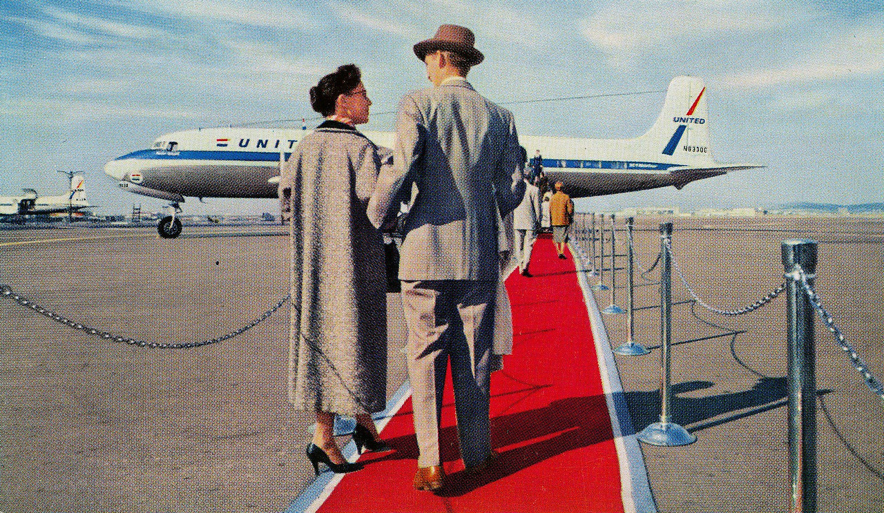 """LIFE ON-BOARD A DC-7 MAINLINER:<br /> <br /> During the 1950's, United Air Lines actually did roll out the red carpet for it's passengers during their promoted """"Red Carpet Service""""."""