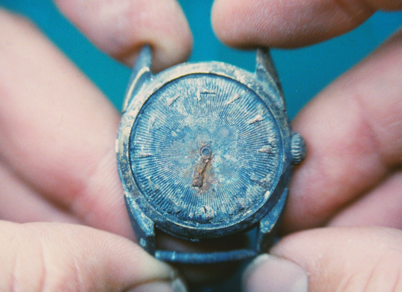 A Bulova Wristwatch with minute hand stopped at the time of impact. Recovered from the United Flight 736 impact site.