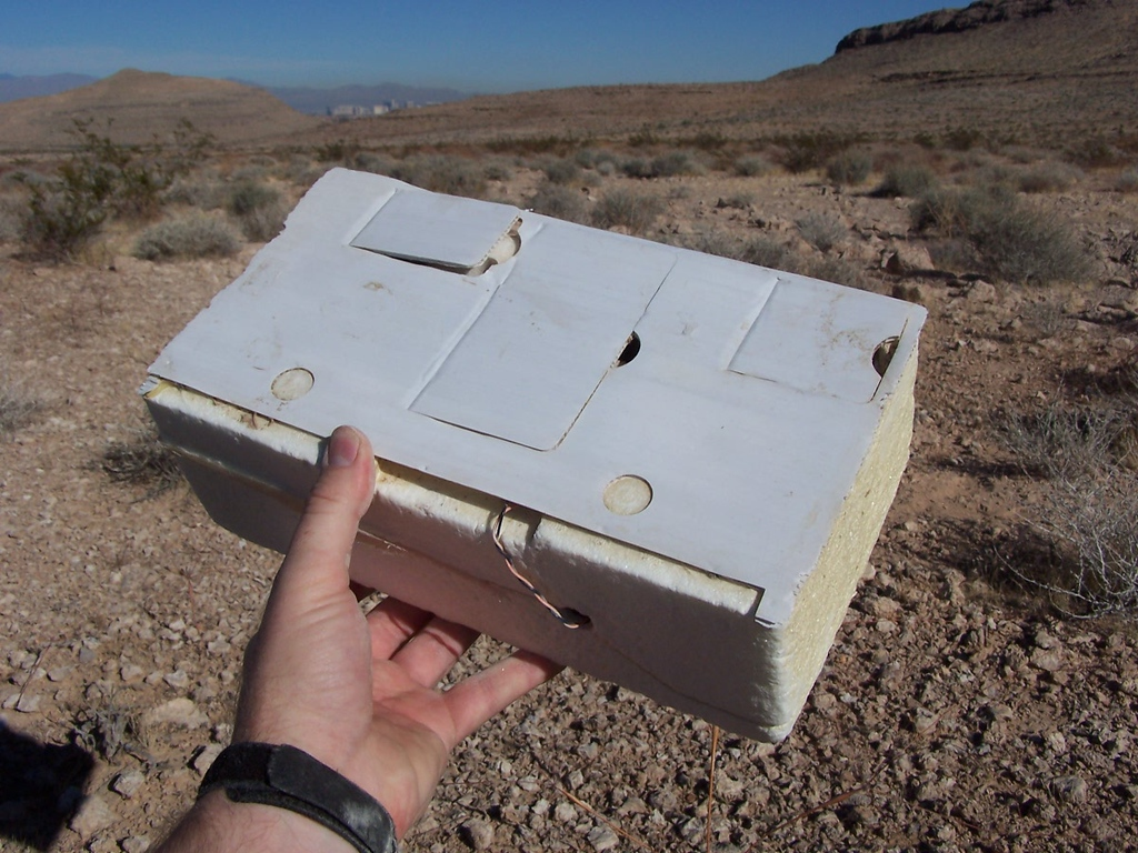 On one trip to the debris field, I discovered an old weather balloon radiosonde. <br /> <br /> According to the paperwork inside, the balloon was launched from Desert Rock, Nevada during February 2001. <br /> <br /> I discovered it five years after it's launch and it was well weathered.