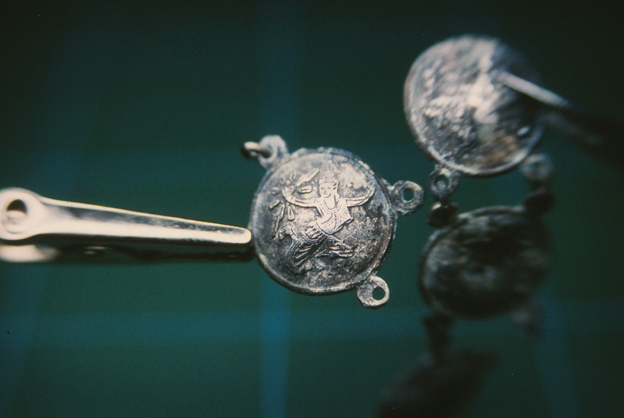 A decorated link from a passenger's sterling silver bracelet that was recovered from the main impact site of Flight 736.