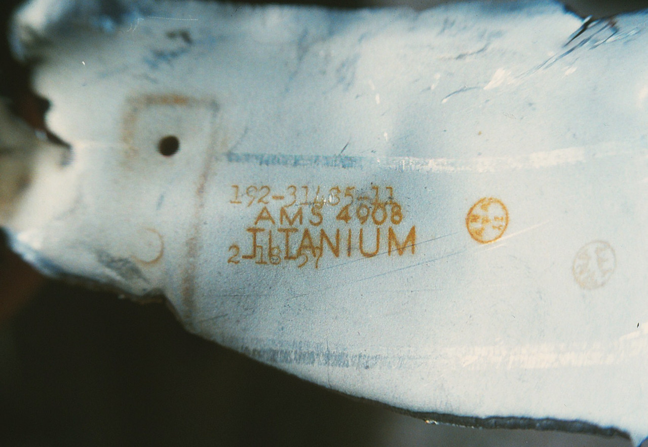 """The fragment was marked """"TITANIUM"""" and included a part numbers, date stamp, and manufacturer stamp from North American Aircraft Co."""
