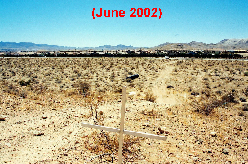 By June 2002, the housing development had been built on the south side of Cactus Road. <br /> <br /> A simple metal cross served as the memorial.