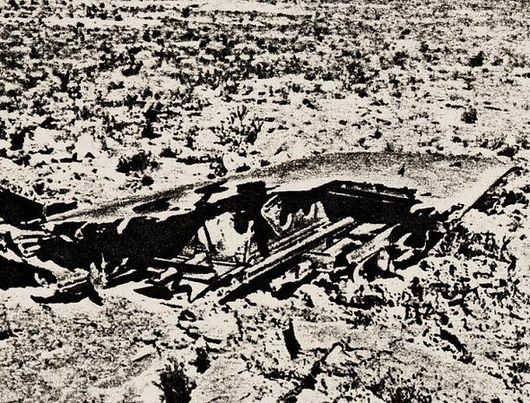 The DC-7's severed starboard wing was located in the open desert between the impact sites of the airliner and military jet.