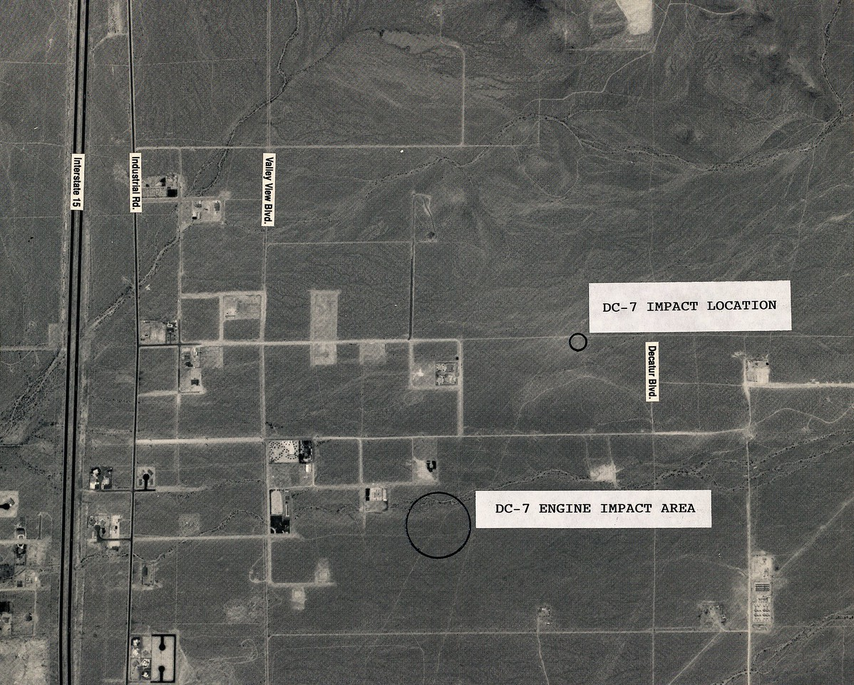 DC-7 ENGINE IMPACT SITE(S):<br /> <br /> This aerial photo taken during 1994, showing the location of the DC-7's main impact site and where the DC-7's three separated engine impact sites were located. <br /> <br /> During 1958, this area was open desert with few if any dirt roads.