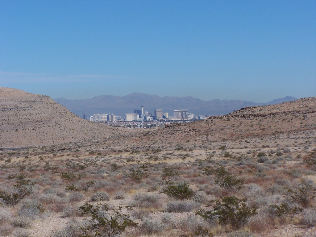 The Las Vegas Strip with it's casinos and hotels can be seen 12 miles away to the north. (LostFlights)