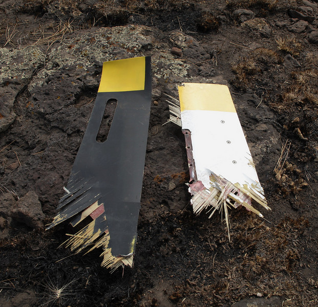 The two rotor blade halves were actually from the same blade but had split in half and separated during the collision. <br /> <br /> The black/yellow side being the lower half of the blade and the white/yellow side being the upper half. (2008 LostFlights)