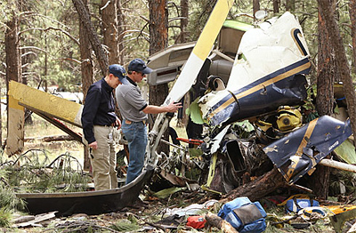 Although there was no fire, the destruction of the Classic Lifeguard helicopter is evident in this photo taken during the NTSB on-site investigation. (AP Photo)
