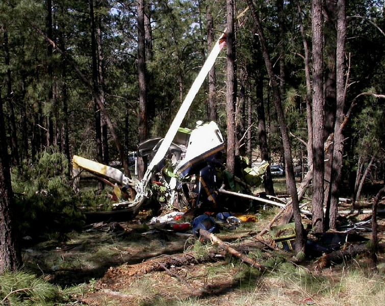 The helicopter operated by Classic Lifeguard crashed on a densely wooded hillside just off Turquoise Drive.<br /> (NTSB Photo)