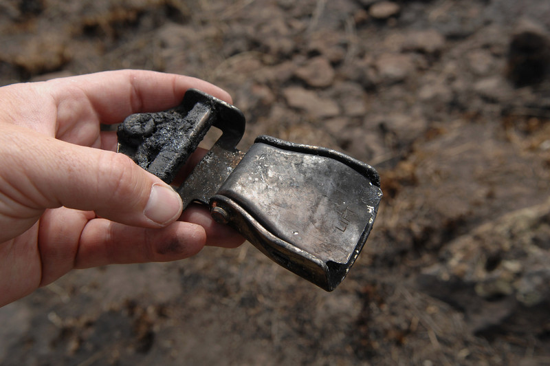 Located at the Guardian Air impact site, a badly burned seat belt buckle and belt tab was found still latched together. <br /> <br /> A closed and latched seat belt buckle is never good to see at a crash site and usually is a reminder that someone probably did not survive the accident. (2008 LostFlights)