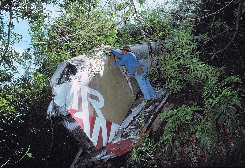 "While it was great to finally reach the tail section, it also became obvious that this was not the main impact site of the DC-9. <br /> <br /> Through research, I would later find out that an attempt to remove the tail section from the impact site failed as the tail started to ""fly"" below the helicopter. Fearing a crash, the pilot of the helicopter released the tail and it fell into this side canyon about a 1/4 mile from where he picked it up. <br /> <br /> Apparently it was decided to be more trouble than it was worth and it was left behind.  (LostFlights File Photo)"