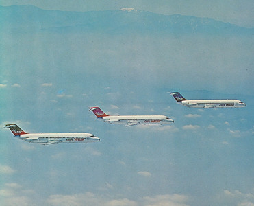 """Back when airlines had money to burn. An airline promotional air to air photo showing the various paint schemes utilized by Hughes Air West during the early 1970s. Aircraft """"N9345"""" is on the bottom left in this formation flight. (LostFlights File Photo)"""